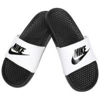 Black and white Nike Slides